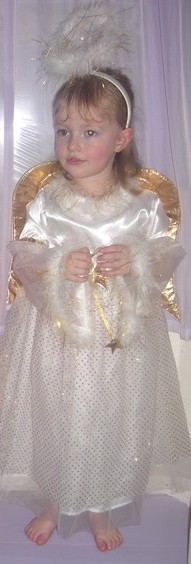 little girl dresses as an angel